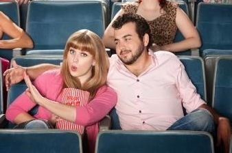 couple at movie theater not in love